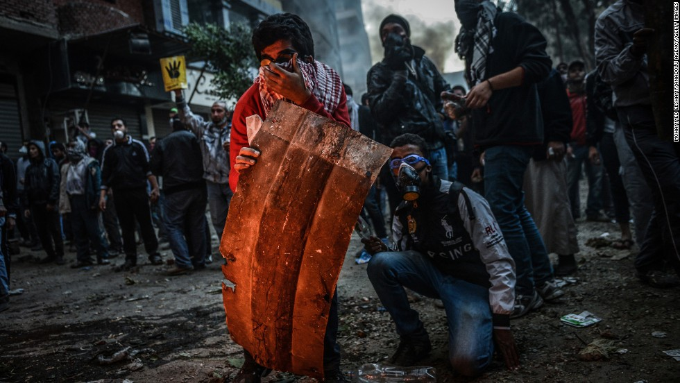 <strong>December 27:</strong> Egyptian protesters and police clash  in Cairo during a demonstration against the government's declaration of the Muslim Brotherhood as a terrorist organization.