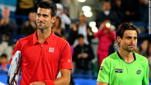 Novak Djokovic, left, beat David Ferrer to win a lucrative exhibition tournament in Abu Dhabi on Saturday.