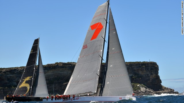 Wild Oats XI, right, cruised to a seventh Sydney-Hobart yacht crown on Saturday, winning by more than three hours.