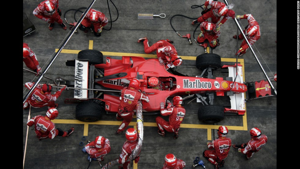 Schumacher's pit team works on his car during the Formula 1 Grand Prix of China in Shanghai in 2006.