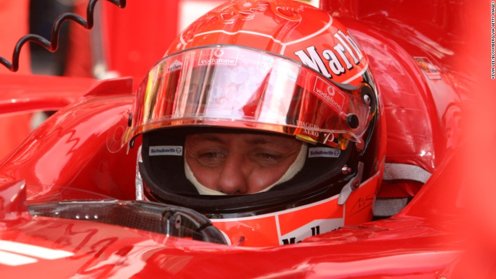 Schumacher sits in his car before the start at the inaugural Chinese Grand Prix in 2004 in Shanghai.