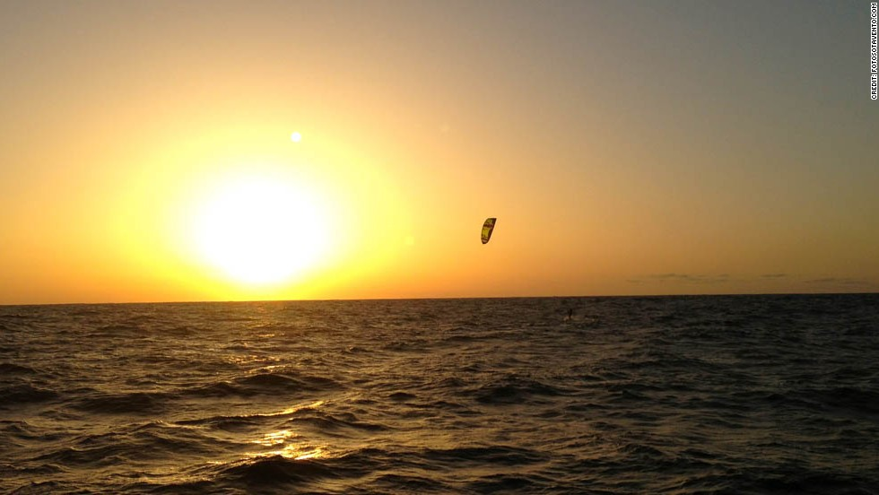Blom is silhouetted against a glorious Atlantic sunset while using a jump technique.
