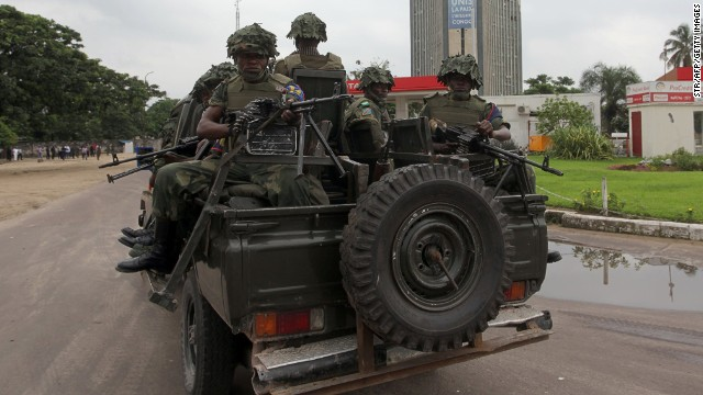 Soldiers of the Democratic Republic of Congo Army patrol in a vehicle after gunfire erupted on December 30 in the capital.
