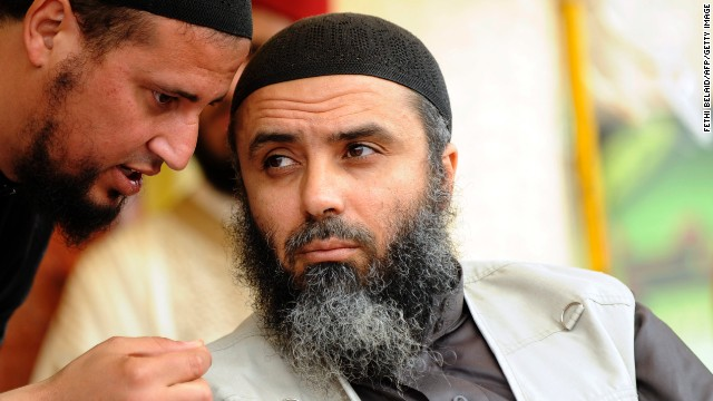 This file photo shows Seifallah Ben Hussein Mokni (R), also known as Abu Iyadh, leader of Tunisian Salafists at a meeting last year in Tunisia.