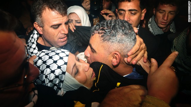 Rami Barbakh, a released Palestinian prisoner, center, is reunited with his mother in the northern Gaza town of Beit Hanoun.