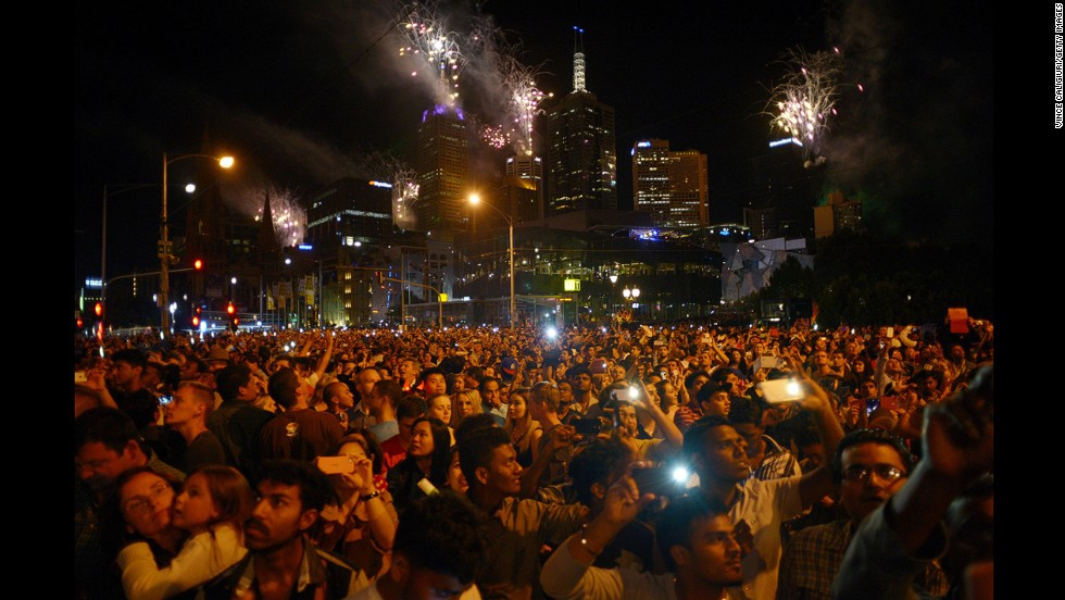 A crowd watches the New Year's fireworks in Melbourne.