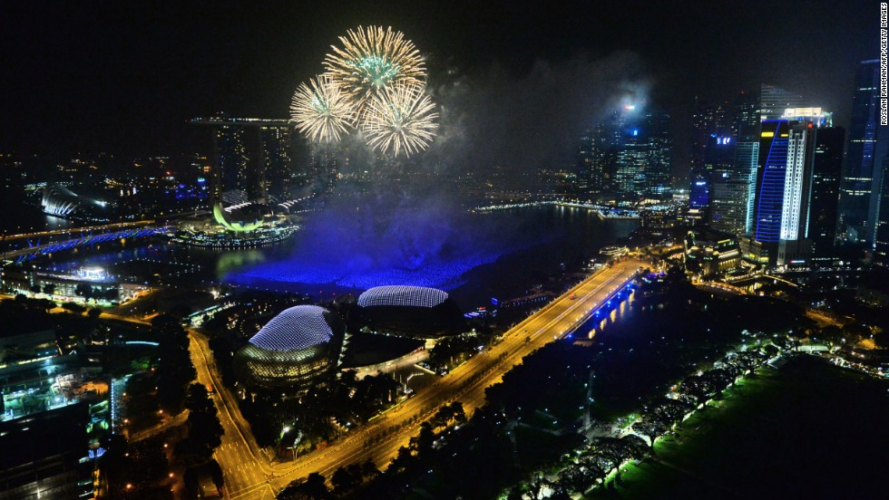 Fireworks burst over the Singapore skyline during New Year's celebrations.