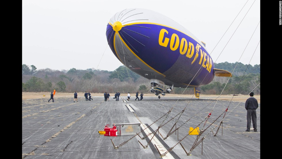 The ground crew scrambles to secure the giant airship. The blimp is one of three Goodyear blimps that tour the country annually.