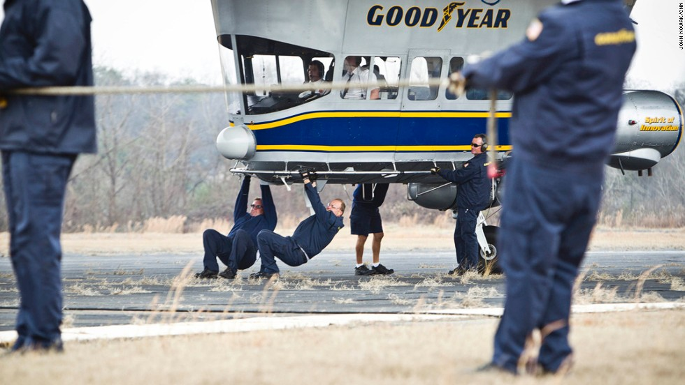 Crew members brace themselves as they pull the Spirit of Innovation to a stop.