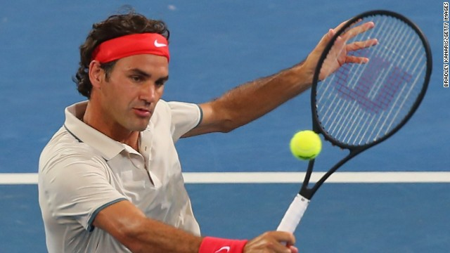 Roger Federer in action in a doubles match in Brisbane using a racket with a bigger head.