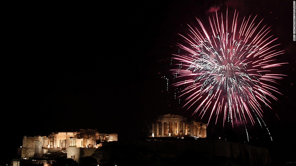 Fireworks burst over the ancient Parthenon temple on the Acropolis hill in Athens, Greece.