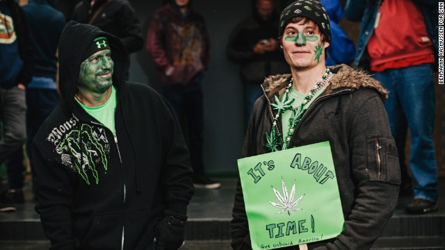 Darren Austin and his son Tyler line up outside the 3D Cannabis Center.