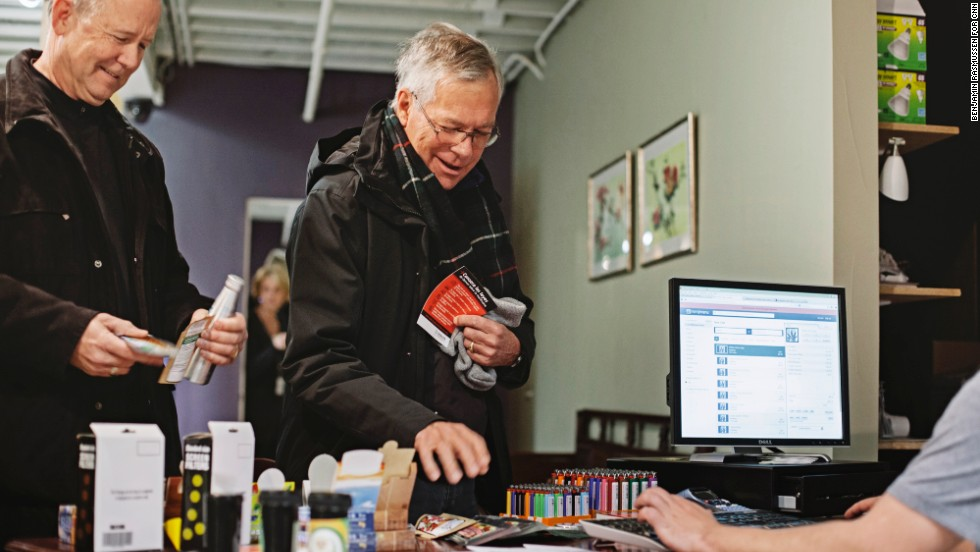 Mark Wootten, left, and Tom McCoy purchase marijuana products at the LoDo Wellness Center.