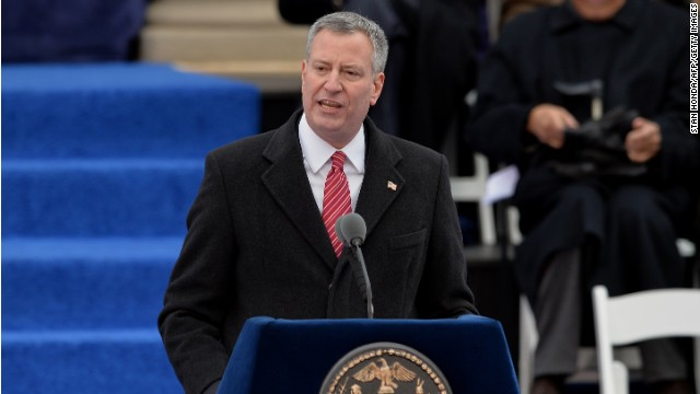 New York City Mayor Bill de Blasio speaks after being sworn in on the steps of City Hall in Lower Manhattan January 1, 2014 in New York. AFP PHOTO/Stan HONDA (Photo credit should read STAN HONDA/AFP/Getty Images)