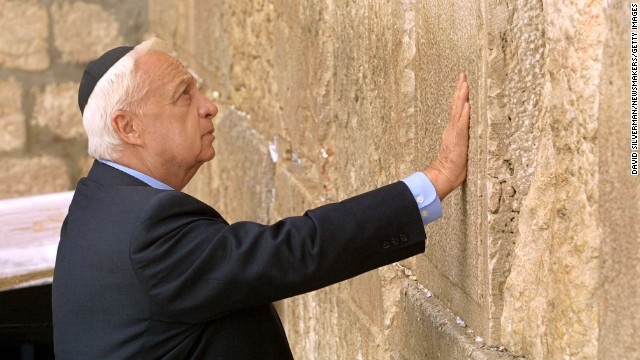 385294 02: Israeli Prime Minister-elect Ariel Sharon touches the ancient stones of the Western Wall as he prays at Judaism's holiest site in Jerusalem's Old City February 7, 2001, the day after he won a resounding victory over Ehud Barak in prime ministerial elections. Sharon wears a Jewish Yarmulka, or skullcap.