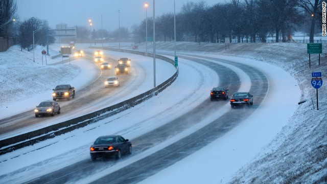 Motorists drive in the snow on I94 in Harper Woods, Michigan, on Wednesday, January 1.