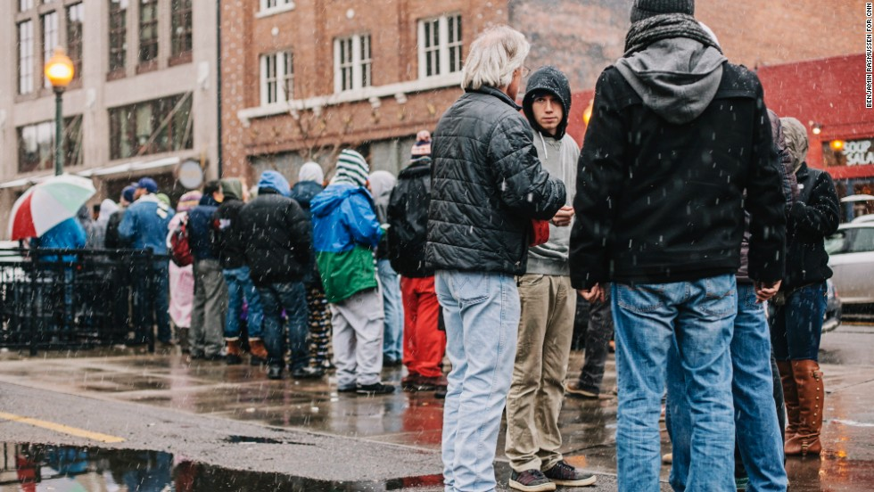 Customers wait in a long line for their turn to buy recreational marijuana outside the LoDo Wellness Center on Wednesday, January 1, in Denver. Colorado is the first state in the nation to allow retail pot shops.