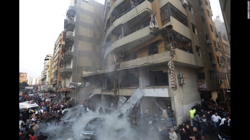 People gather at the site of the explosion. The blast was strong enough to be felt in nearby neighborhoods, reported Lebanon's state-run National News Agency.