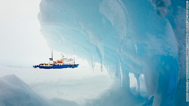 This image taken by passenger Andrew Peacock of www.footloosefotography.com on December 30, 2013 shows the ship MV Akademik Shokalskiy still stuck in the ice off East Antarctica, as it waits to be rescued. An Australian icebreaker was on December 30 battling against bad weather to reach a ship carrying a scientific expedition stranded off Antarctica, leaving open the possibility of a helicopter evacuation, authorities said. The ship is carrying scientists and tourists who are following the Antarctic path of explorer Douglas Mawson a century ago, details of which at www.spiritofmawson.com, and have been carrying out the same scientific experiments his team conducted during the 1911-1914 Australian Antarctic Expedition -- the first large-scale Australian-led scientific expedition to the frozen continent. RESTRICTED TO EDITORIAL USE AFP PHOTO / MANDATORY CREDIT: Andrew Peacock / www.footloosefotography.comAndrew Peacock/AFP/Getty Images