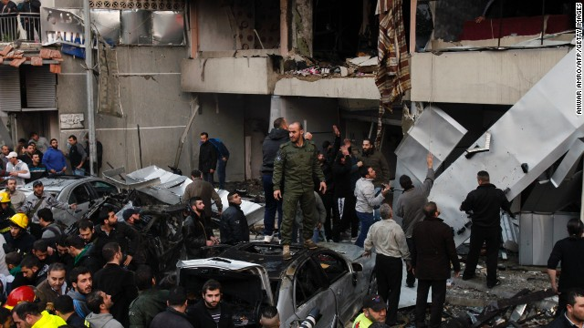 Lebanese people gather at the site of a car bomb that targeted Beirut's southern suburb of Haret Hreik on January 2, 2014.