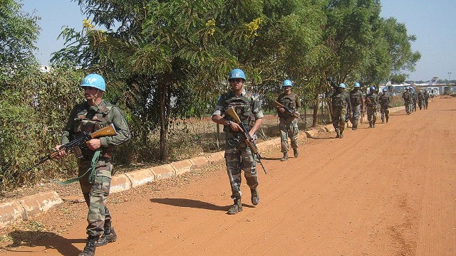 A handout photo released by UNMISS on December 20, 2013 shows Indian peacekeepers patrolling on a road in Juba, on December 16, 2013. South Sudan's fugitive former vice president denied on December 18 accusations he led a coup bid against his archrival President Salva Kiir after days of fierce fighting that has killed hundreds of people and sent thousands fleeing to UN bases. Three Indian peacekeepers were killed on December 19, 2013 in an attack on a UN base in South Sudan, as fighting between rebels and government forces increased fears the world's youngest state was sliding towards civil war. AFP PHOTO / UNMISSHO/AFP/Getty Images