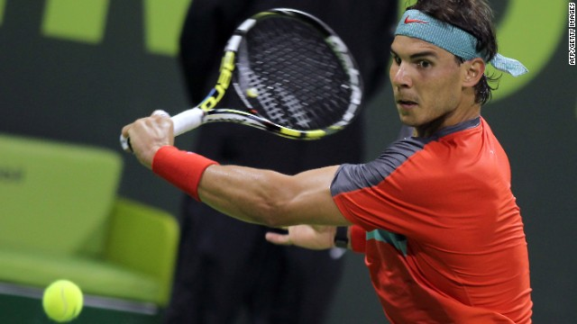 Rafael Nadal plays a backhand during hs battling straight sets win over Ernests Gulbis in the Qatar Open quarterfinals.