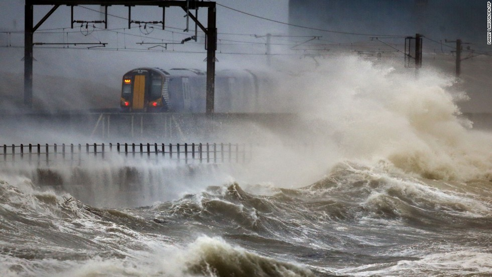 A train passes along the coast at Saltcoats, Scotland, on January 3.