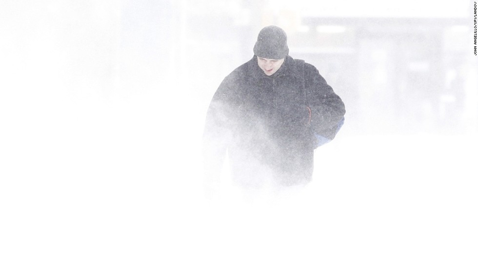 A man walks through the snow as the wind kicks it up January 3 in New York City.
