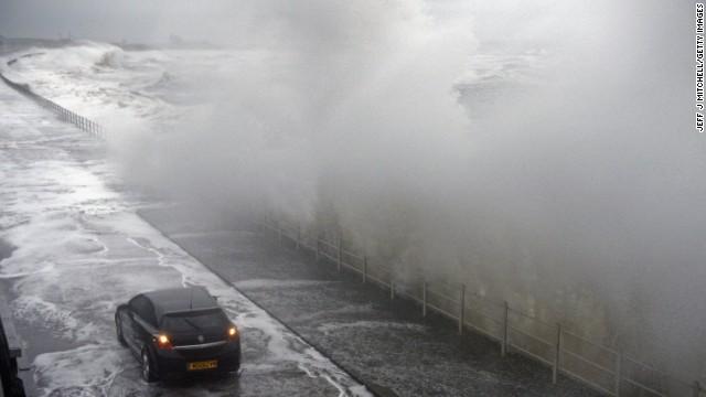 Waves break over the Saltcoats Esplanade on January 3 in Saltcoats, Scotland.