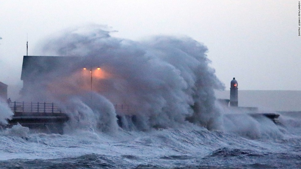 Huge waves crash against the promenade wall in Porthcawl, Wales, on January 3.