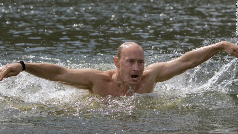 Putin braved the waters in southern Siberia during a vacation to show off his swimming skills.