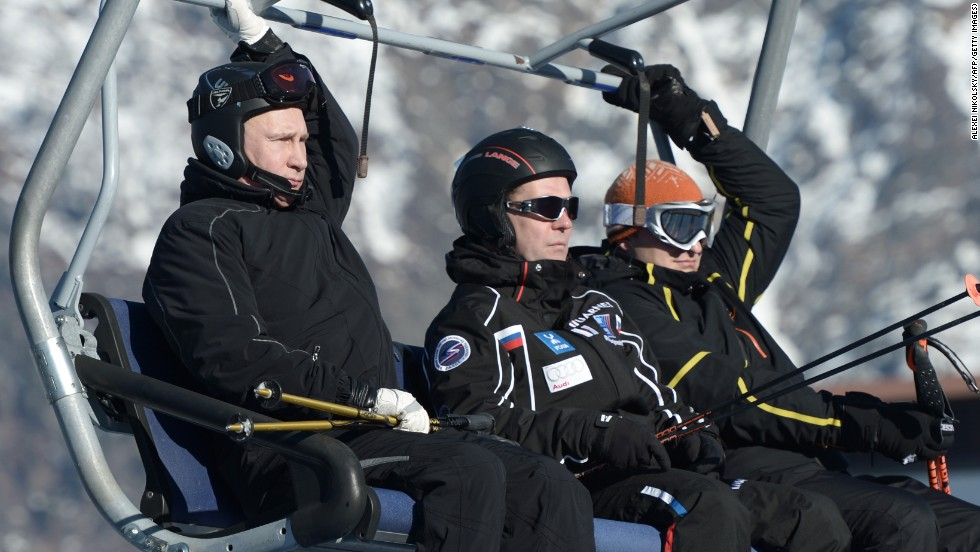Putin and his Prime Minister Dmitry Medvedev ride in a cable car as they visit the Cross Country and Biathlon Center in Sochi.