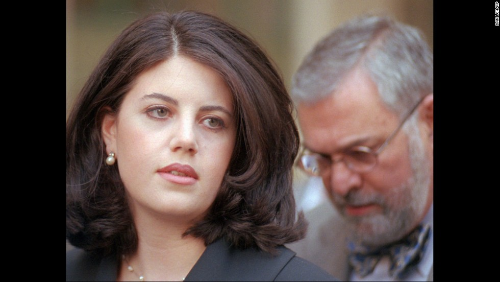Lewinsky and her attorney, William Ginsburg, head to their car in Philadelphia on April 6, 1998.