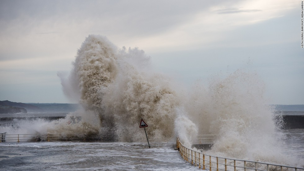 Huge waves batter the seaside and promenade at Aberystwyth on January 4 in Wales.