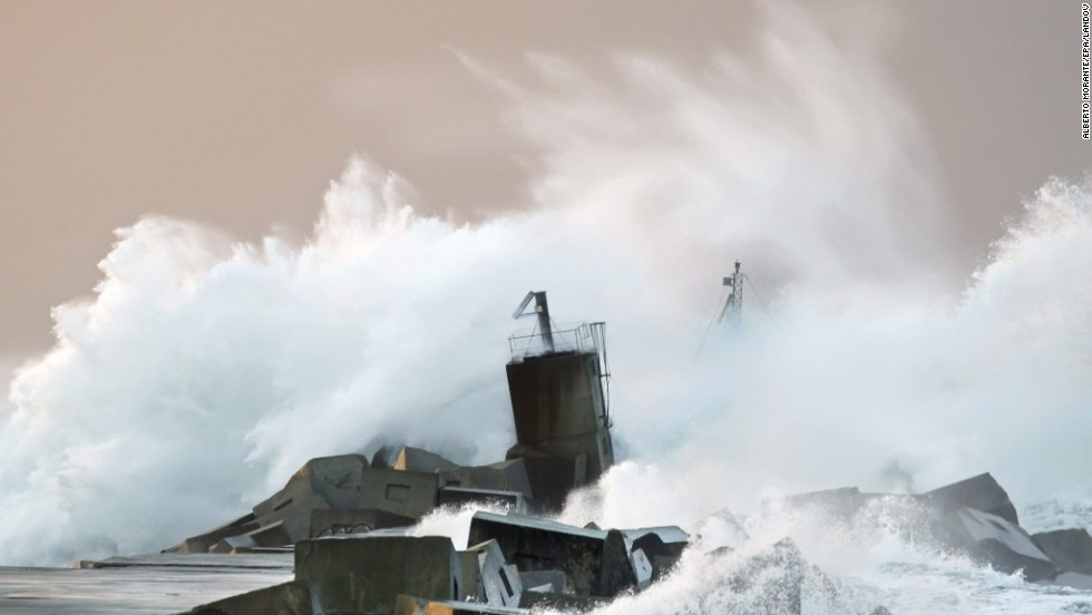 Waves crash against a breakwater along the San Juan de Nieva coast near Aviles in northern Spain on January 4.