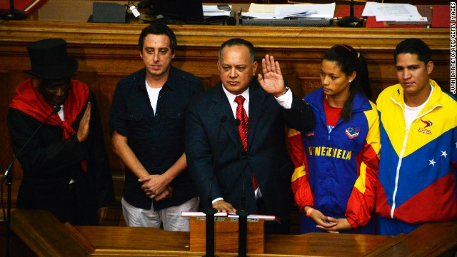 Venezuelan Parliament President Diosdado Cabello (C) takes the oath to continue as president in 2014, in the National Assembly, in Caracas on January 5, 2014. AFP PHOTO/JUAN BARRETO (Photo credit should read JUAN BARRETO/AFP/Getty Images)