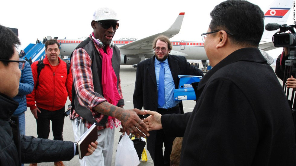 Son Kwang Ho, vice minister of North Korea's Sports Ministry, greets Rodman at the airport in Pyongyang in January 2014.