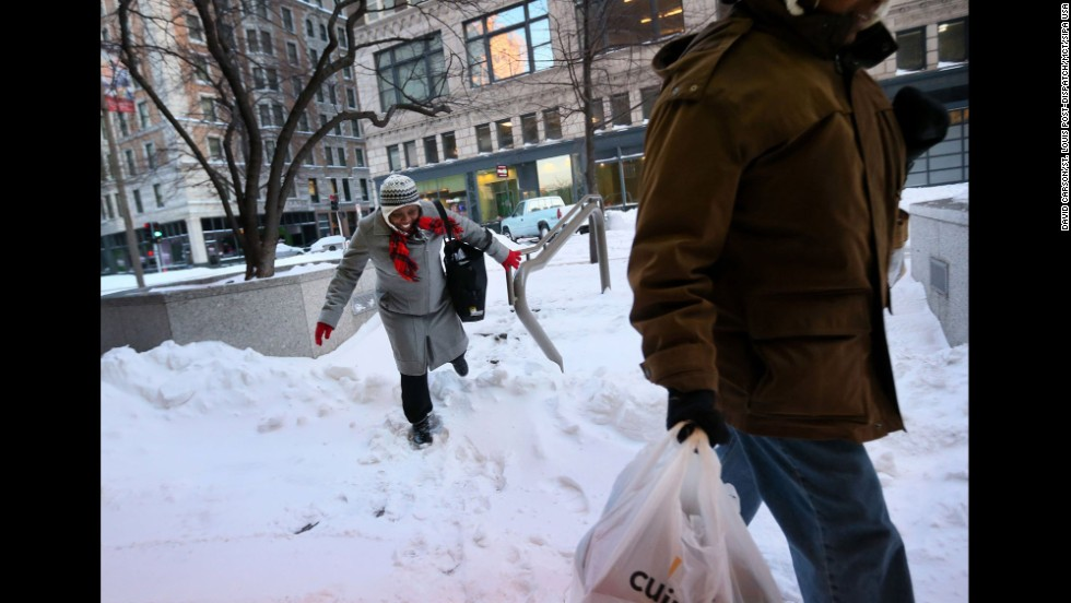 A woman makes her way through a snow drift in downtown St. Louis on January 6.