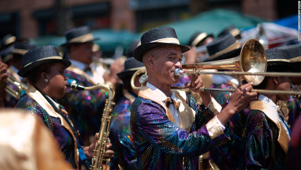 A wide variety of instruments, including trumpets, saxophones and banjos, accompany the parading troupes across the city.