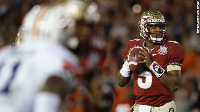 Quarterback Jameis Winston of the Florida State Seminoles looks to pass against the Auburn.