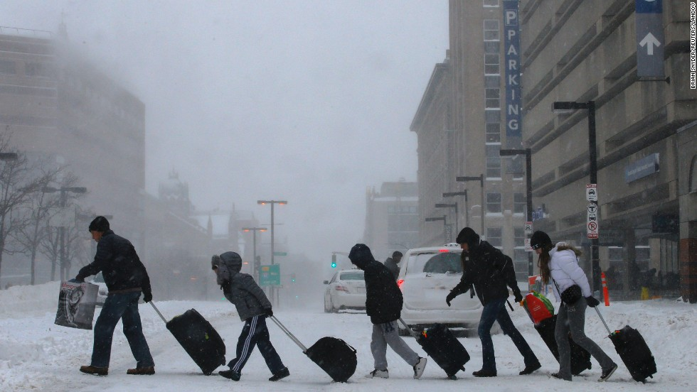 Travelers in Boston leave the Back Bay train station on January 3.