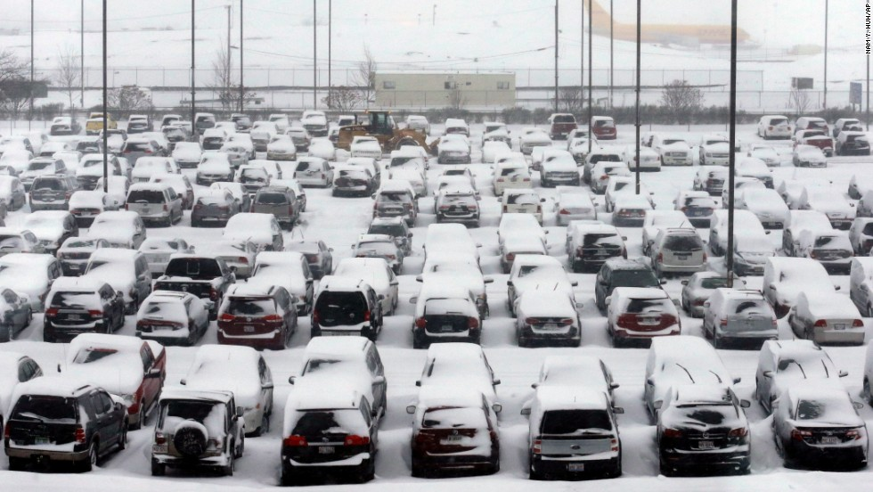 Cars sit covered in snow at Chicago O'Hare International Airport on Thursday, January 2.