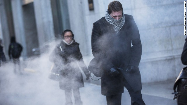 A man clenches his fists while walking past a steam vent in New York City on Tuesday, January 7.