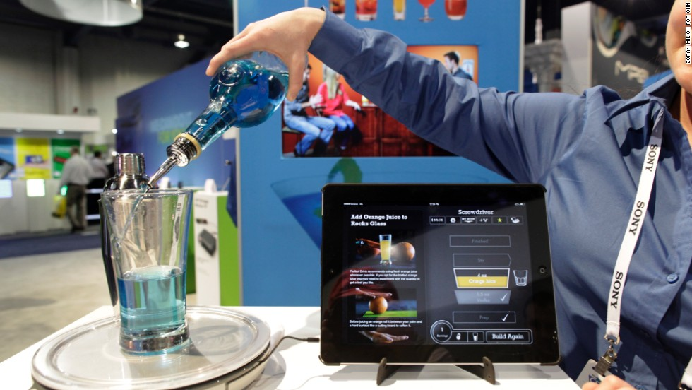 This is a demonstration of Perfect Drink, an app-controlled bartending scale by Brookstone.