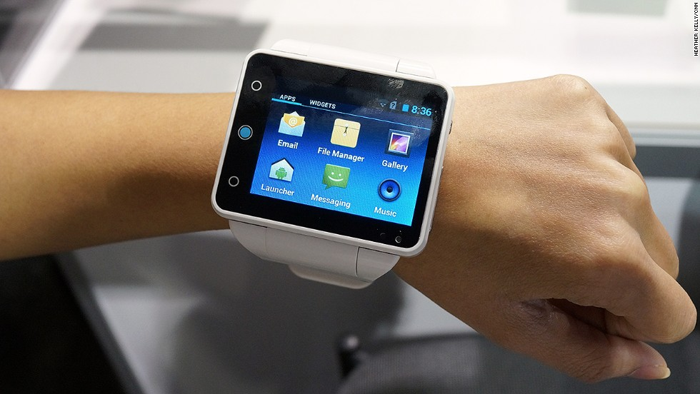 "Big watch or tiny phone? The bulky 2.4-inch touchscreen <a href=""http://www.neptunepine.com/"" target=""_blank"">Neptune Pine</a> smart watch runs Android Jelly Bean and is a fully functioning phone. It will cost $335 to $395 when it's released in March."