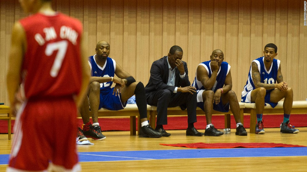 "Former NBA star Eric ""Sleepy"" Floyd, center, sits with fellow American basketball players."
