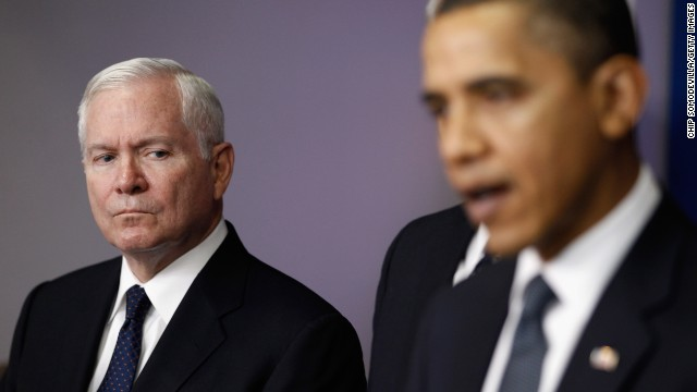 Then-Defense Secretary Robert Gates istens to President Barack Obama make a statement to reporters in 2010.