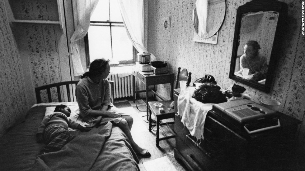 In 1971, a woman and child rest in their room at a New York City hotel for people living on welfare. Johnson's programs significantly reduced the poverty rate during his time in office, but it was still in the double digits (12.1%) when he left in 1969.