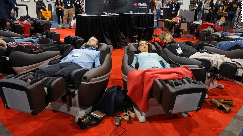 People test out the $8,000 Inada massage chairs at CES.