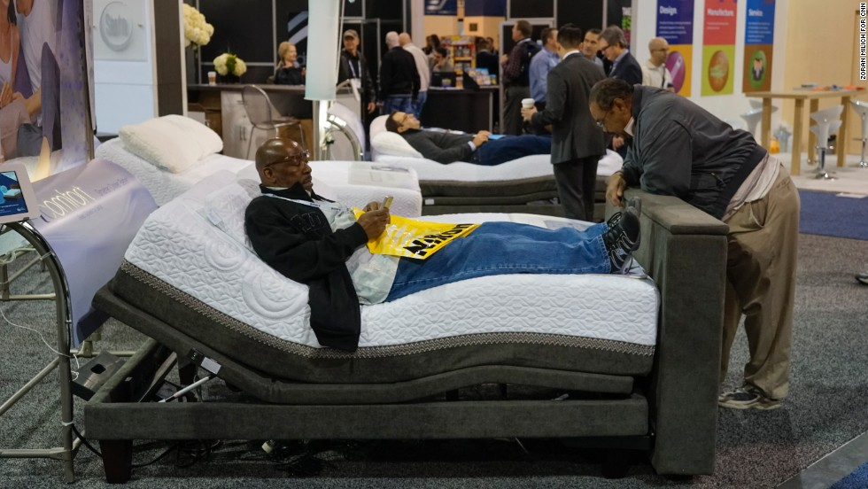 A man takes the Epic iComfort Directions bed with the Motion Comfort base by Serta for a test drive.  The bed, which includes Bluetooth, speakers, subwoofer, USB ports and six levels of massage is available now and lists at $5,774.